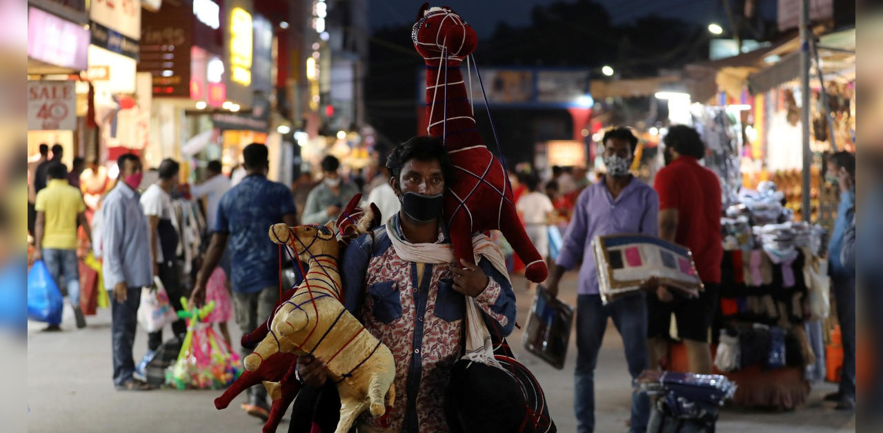 A man selling stuffed toys waits for customers at a market amidst the spread of the coronavirus, in New Delhi, India, September 16, 2020. Credit: Reuters Photo