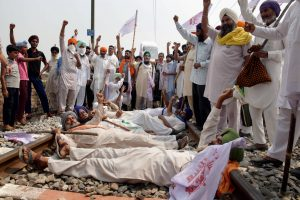 Amritsar: Farmers block a railway track as they participate in 'Rail Roko Andolan' during a protest against the farm bills passed in both the Houses of Parliament recently, at village Devi Dass Pura, about 20km from Amritsar, Thursday, Sept. 24, 2020. (PTI Photo)(PTI24-09-2020_000091B)