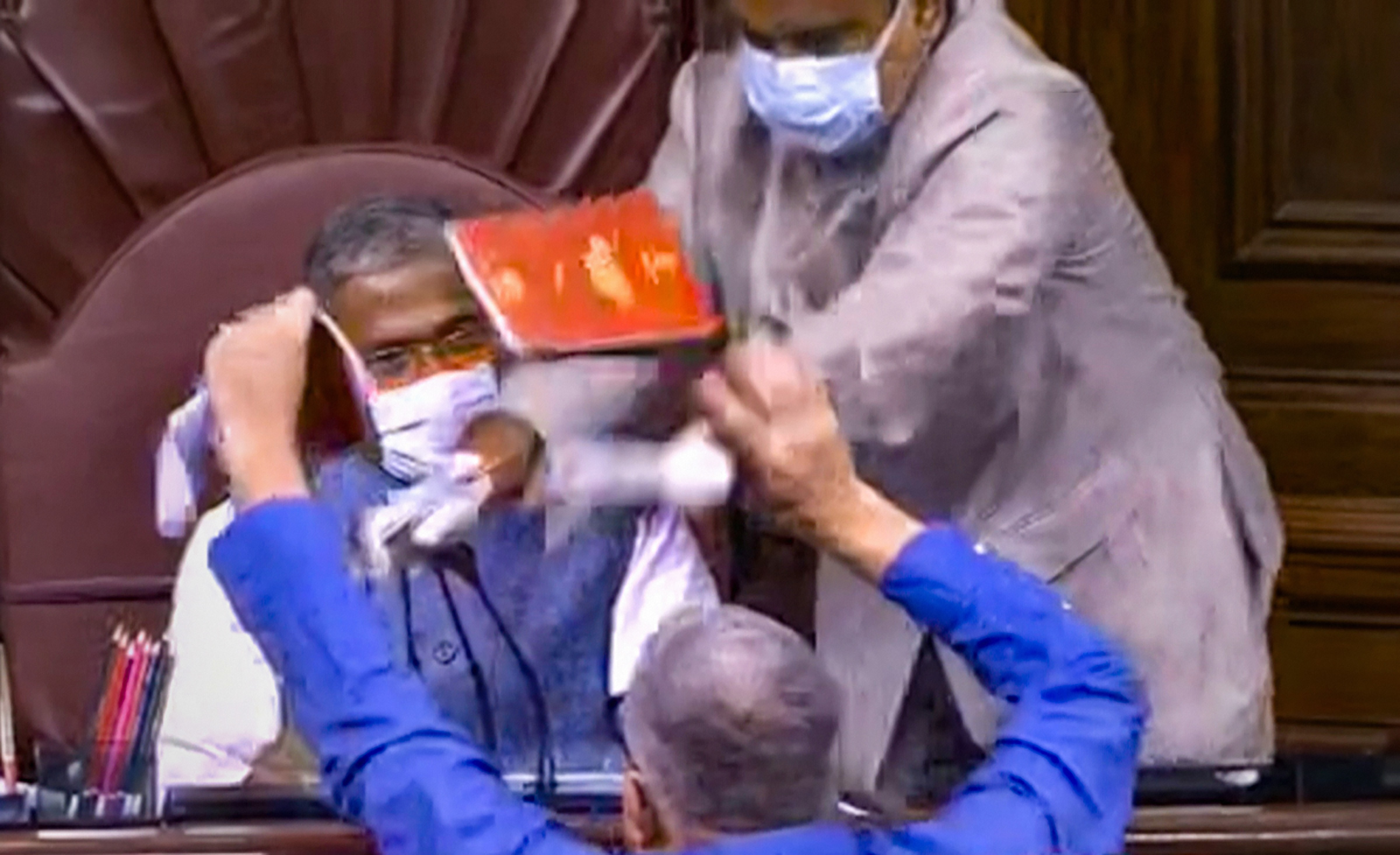 **EDS: VIDEO GRAB** New Delhi: TMC MP Derek O'Brien attempts to tear the rule book as ruckus erupts in the Rajya Sabha over agriculture related bills, during the ongoing Monsoon Session, at Parliament House in New Delhi, Sunday, Sept. 20, 2020. (RSTV/PTI Photo)(PTI20-09-2020_000118B)