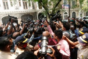 Media personnel surround Bollywood actor Rhea Chakraborty as she arrives at Narcotics Control Bureau (NCB) office for questioning, following the death of her boyfriend and actor Sushant Singh Rajput, in Mumbai, India, September 6, 2020. Picture taken September 6, 2020. REUTERS/Francis Mascarenhas