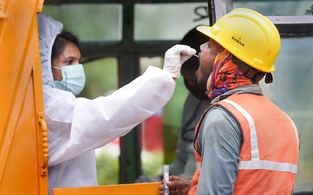 Chennai: A health worker collects swab sample from a migrant worker for COVID-19 test, in Chennai, Monday, Oct. 19, 2020. (PTI Photo/R Senthil Kumar)(PTI19-10-2020 000182B)