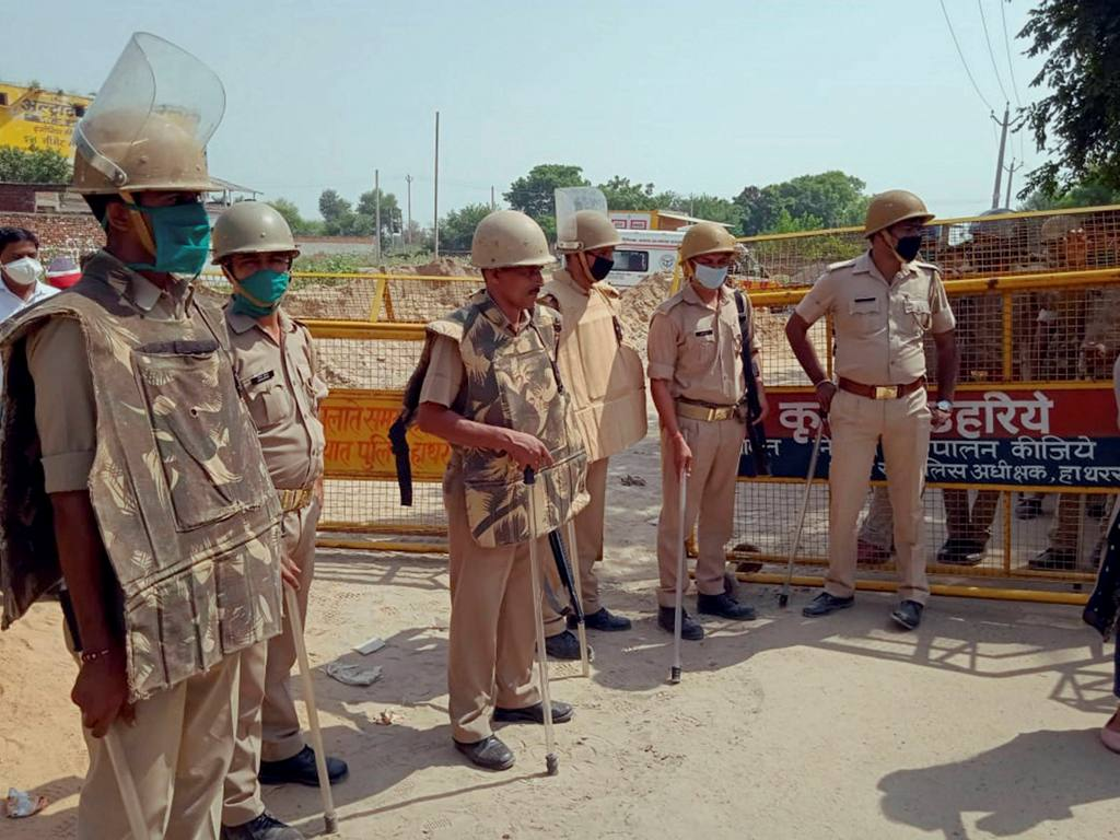 Hathras: Police personnel stand guard at the entrance of Bulgadi village where the family of 19-year-old Dalit woman who was gang-raped two weeks ago resides, in Hathras district, Thursday, Oct. 1, 2020. (PTI Photo)(PTI01-10-2020 000067B)
