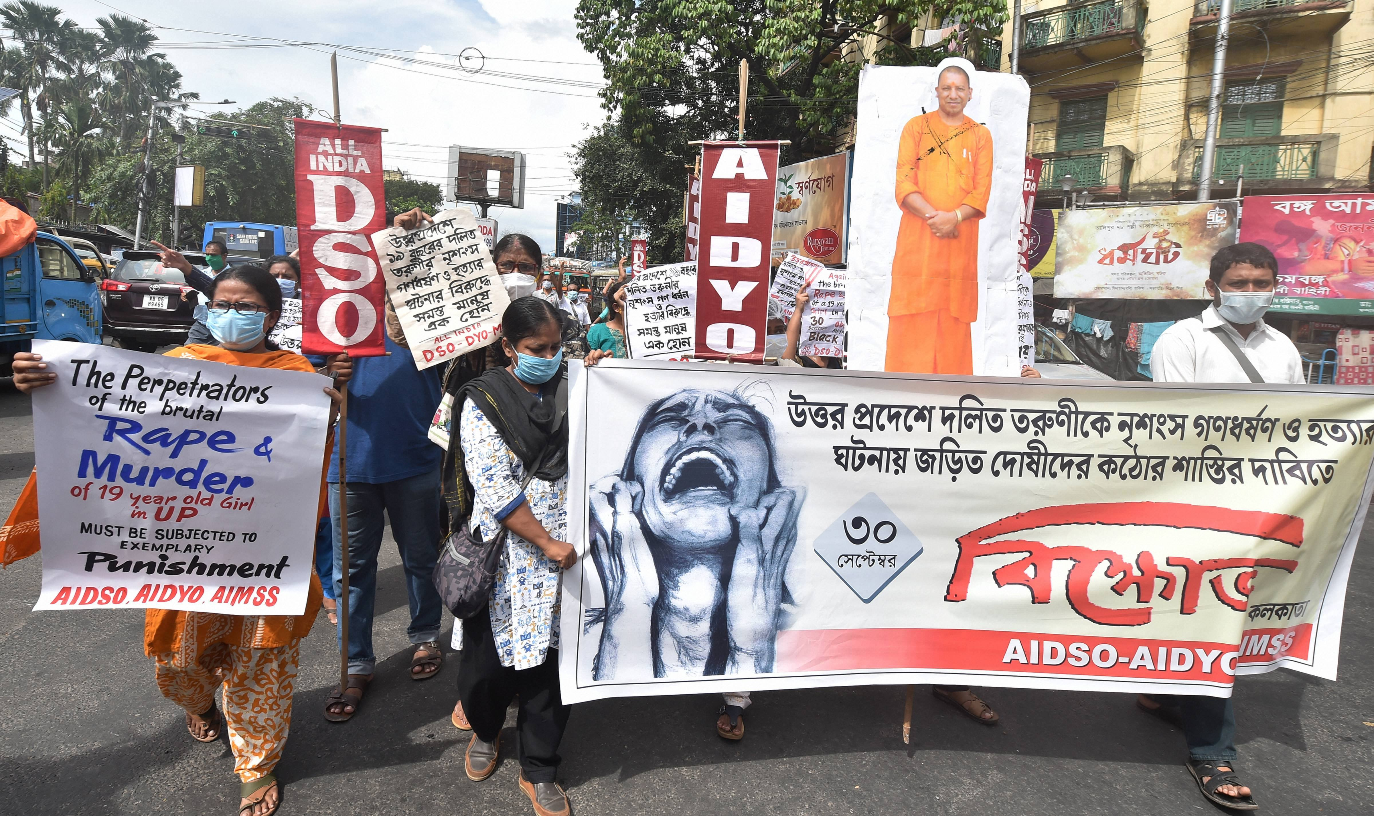 Kolkata: Activists of Socialist Unity Centre of India (SUCI) hold placards and a cutout of Chief Minister Yogi Adityanath during a protest over the death of Hathras gang-rape victim, in Kolkata, Wednesday, Sept 30, 2020. (PTI Photo/Swapan Mahapatra)(PTI30-09-2020_000151B)