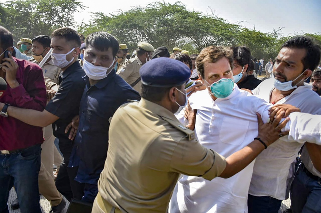 Noida: Congress leader Rahul Gandhi being stopped by police personnel while he was on his way to Hathras along with party workers to meet the family members of a 19-year-old Dalit woman who was murdered and gang-raped two weeks ago after his vehicle was stopped by the authorities, at Yamuna Expressway in Noida, Thursday, Oct. 1, 2020. (PTI Photo)(PTI01-10-2020 000115B)