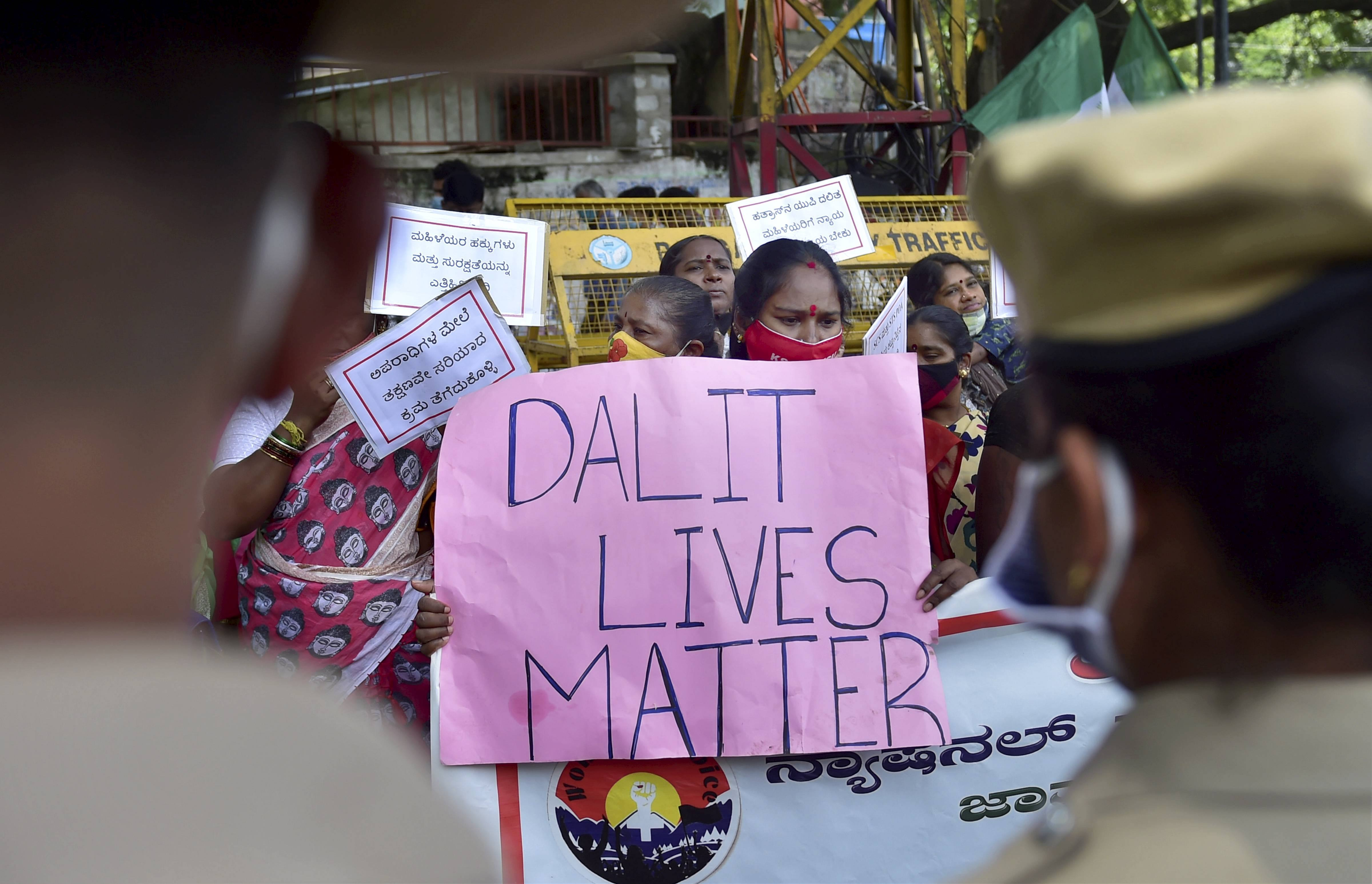 Bengaluru: Janata Dal (S) women workers along with other activists display placards and raise slogans during a protest demanding justice for Hathras incident victim, in Bengaluru, Saturday, Oct. 3, 2020. A 19-yr old Dalit woman of Hathras died allegedly after being gan-raped two weeks ago. (PTI Photo/Shailendra Bhojak)(PTI03-10-2020_000125B)