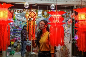 Ahmedabad: A woman shops for decorative lights ahead of Diwali festival, in Ahmedabad, Wednesday, Nov. 11, 2020. (PTI Photo)(PTI11-11-2020 000162B)