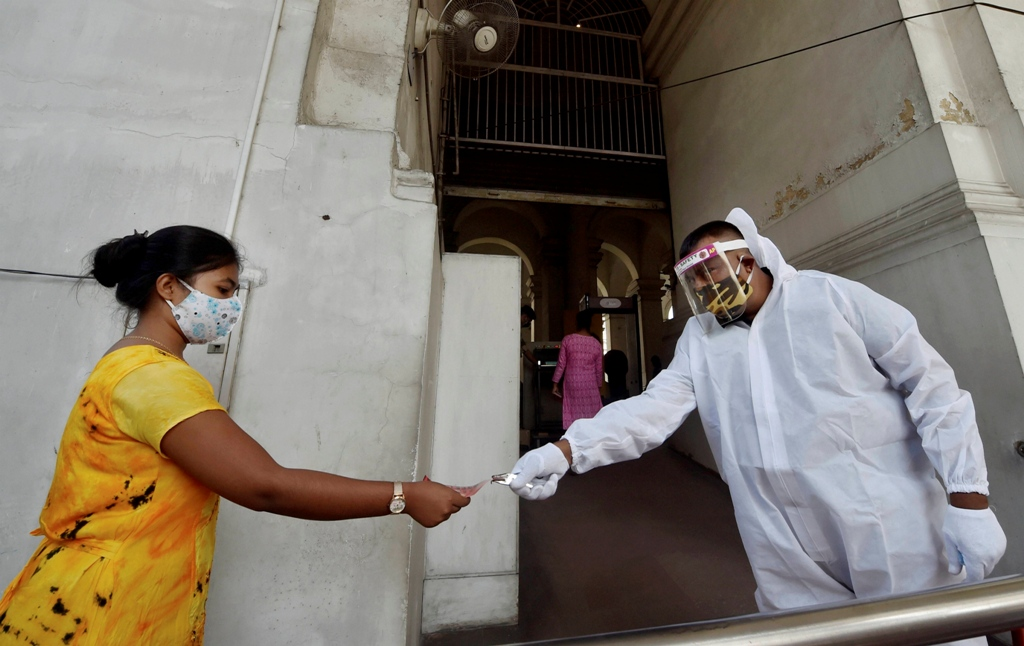 Kolkata: A security personnel wearing PPE kit checks ticket of a visitor at the Indian Museum that was reopened as per guidelines of the Unlock 6.0, in Kolkata, Tuesday, Nov. 10, 2020. (PTI Photo/Ashok Bhaumik)(PTI10-11-2020 000076B)