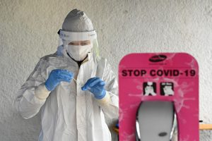 A healthcare worker tests a sample at a coronavirus disease testing site during nationwide testing, in Trencin, Slovakia, on October 31, 2020. Reuters
