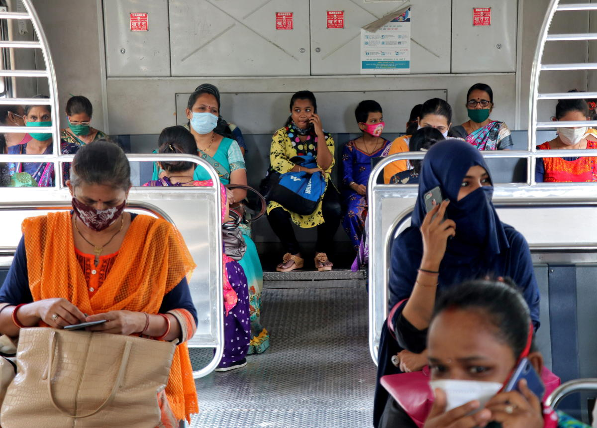 Women wearing protective face mask commute in a suburban train after authorities resumed the train services for women passengers during non-peak hours, amidst the coronavirus disease outbreak, in Mumbai, India, October 21, 2020. Credit: Reuters