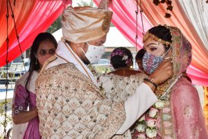 Surat: Bride and groom, wearing masks, perform rituals during their marriage ceremony amid the ongoing coronavirus pandemic, in Surat, Thursday, Nov. 26, 2020. (PTI Photo)(PTI26-11-2020 000169B)