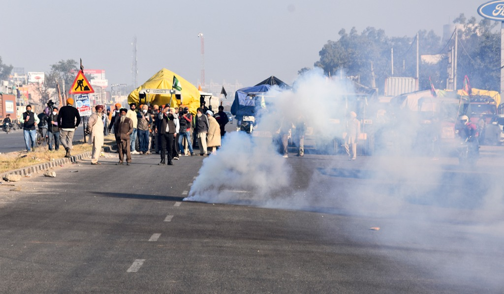New Delhi: Teargas shells fired by Delhi Police land near protesting farmers to warn them, as they try to cross the border into Delhi during their Delhi Chalo protest against Kisan Bill, at Singhu border in New Delhi, Friday, Nov 27, 2020. (PTI Photo)(PTI27-11-2020 000013B)
