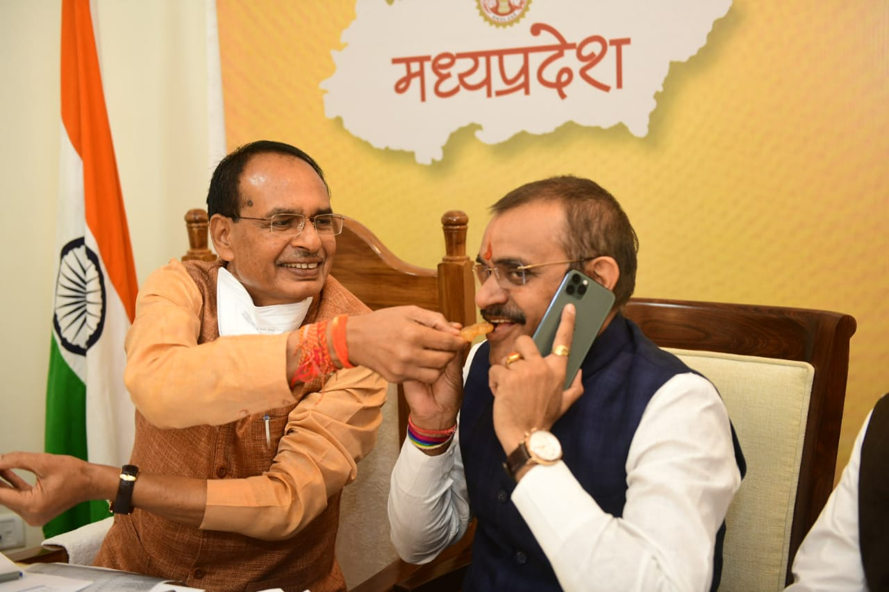 **EDS: TWITTER IMAGE POSTED BY @ChouhanShivraj ON TUESDAY, NOV. 10, 2020** Bhopal: Madhya Pradesh Chief Minister Shivraj Singh Chouhan and BJP State President VD Sharma greet each other as they celebrate their partys lead in Madhya Pradesh bypolls, in Bhopal.