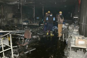 Rajkot: Firefighters inside the ICU of a designated COVID-19 hospital where the fire broke out today, in Rajkot, Friday, Nov. 27, 2020. Five COVID-19 patients died in the incident. (PTI Photo)(PTI27-11-2020 000061B)