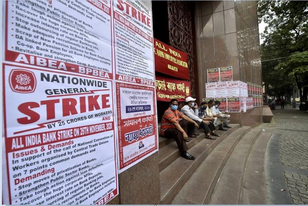 Kolkata: Bank Union members and employees sit outside the main gate of Reserve Bank of India (RBI) during a nationwide strike called by various central trade unions against different policies of the NDA government, in Kolkata, Thursday, Nov 26, 2020. (PTI Photo/Swapan Mahapatra)(PTI26-11-2020 000113B)