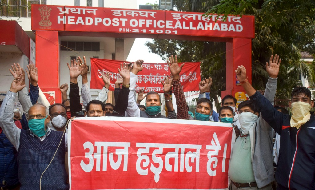 Prayagraj: Employees of GPO shout slogans during the nationwide strike by ten central trade unions against various policies of the NDA government, in Prayagraj, Thursday, Nov. 26, 2020. (PTI Photo)(PTI26-11-2020 000108B)