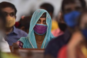 Chennai: A devotee wearing mask amid concern over the spread of coronavirus attends a mid-night Christmas mass service at Santhome Church, in Chennai, Friday, Dec. 25, 2020. (PTI Photo/R Senthil Kumar) (PTI25-12-2020_000071B)