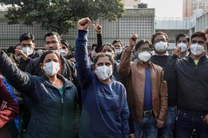New Delhi: Members of AIIMS Nurses Union raise slogans during their indefinite strike over their long-pending demands, including those concerning the Sixth Central Pay Commission and against contractual appointments, in New Delhi, Tuesday, Dec. 15, 2020. (PTI Photo/Atul Yadav)(PTI15-12-2020 000097B)