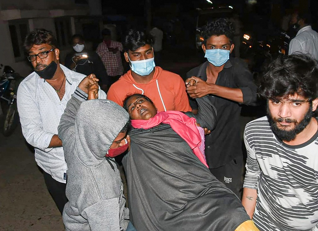 West Godavari: A woman showing symptoms of epilepsy being taken to a hospital in Eluru town of West Godavari district, Sunday, Dec. 6, 2020. Over 200 people from different parts of Eluru were hospitalized with symptoms resembling epilepsy. (PTI Photo) (PTI06-12-2020 000171B)