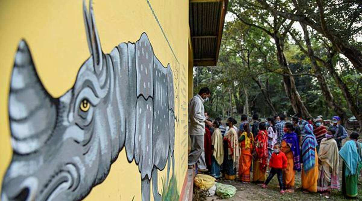 People stand in a queue to vote during the Bodoland Territorial Regions election, at a polling station in Baksa district of Assam on December 7, 2020 PTI Photos