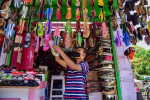 A shopkeeper arranges shoes at his store as he waits for customers after authorities eased restrictions during the ongoing COVID-19 nationwide lockdown in Nagaon district, Assam May 4 2020. (Photo | PTI)