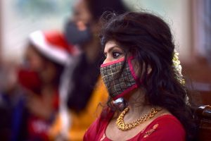Chennai: A devotee wearing mask amid concern over the spread of coronavirus attends a mid-night Christmas mass service at Santhome Church, in Chennai, Friday, Dec. 25, 2020. (PTI Photo/R Senthil Kumar) (PTI25-12-2020 000073B)