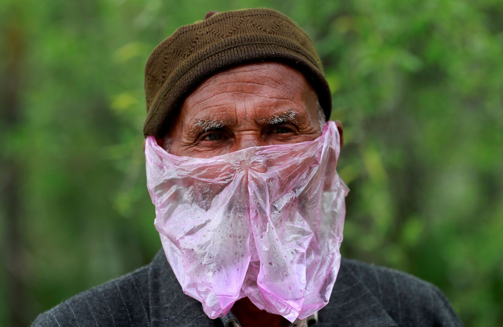 A man uses a plastic bag as a mask amid concerns about the spread of coronavirus disease (COVID-19), in Srinagar April 7, 2020. REUTERS/Danish Ismail     TPX IMAGES OF THE DAY