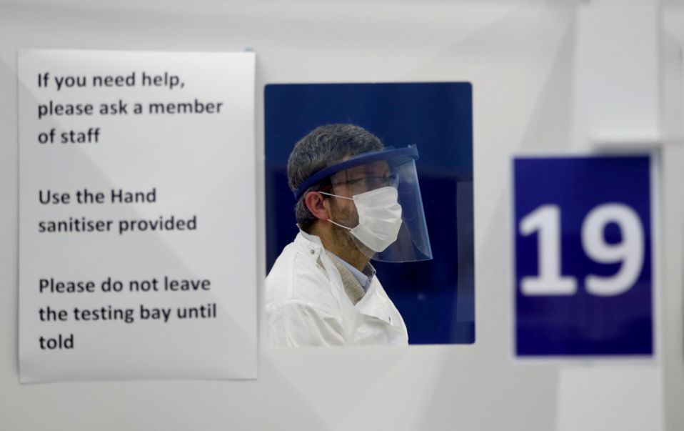 An employee attends testing of a lateral flow antigen test facility, amid the spread of the coronavirus disease (COVID-19), in St Andrews, Scotland, Britain, November 27, 2020. REUTERS/Russell Cheyne - RC2NBK9FKUU3