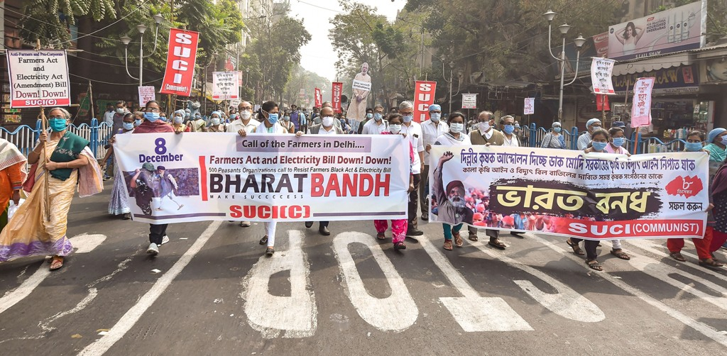 Kolkata: Socialist Unity Centre of India (SUCI) activists participate in a rally in support of the nationwide strike, called by farmers to press for repeal of the Centres agri laws, in Kolkata, Tuesday, Dec. 8, 2020. (PTI Photo/Swapan Mahapatra)(PTI08-12-2020 000042B)