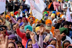 Amritsar: Farmers raise slogans during a protest in support of the nationwide strike, called by farmer unions to press for repeal of the Centres Agri laws, in Amritsar, Tuesday, Dec. 8, 2020. (PTI Photo)(PTI08-12-2020 000197B)