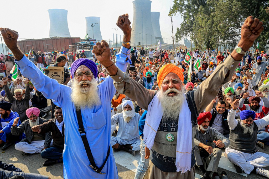 Bathinda: Bharatiya Kisan Union (BKU) activists block NH-15 in support of the nationwide strike, called by farmers to press for repeal of the Centres Agri laws, in Bathinda, Tuesday, Dec. 8, 2020. (PTI Photo)(PTI08-12-2020 000165B)