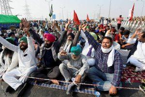 New Delhi: Farmers shout slogans during their protest against the new farm laws, at Delhi-Meerut Expressway in New Delhi, Friday, Dec. 4, 2020. (PTI Photo/Kamal Singh)(PTI04-12-2020 000035B)