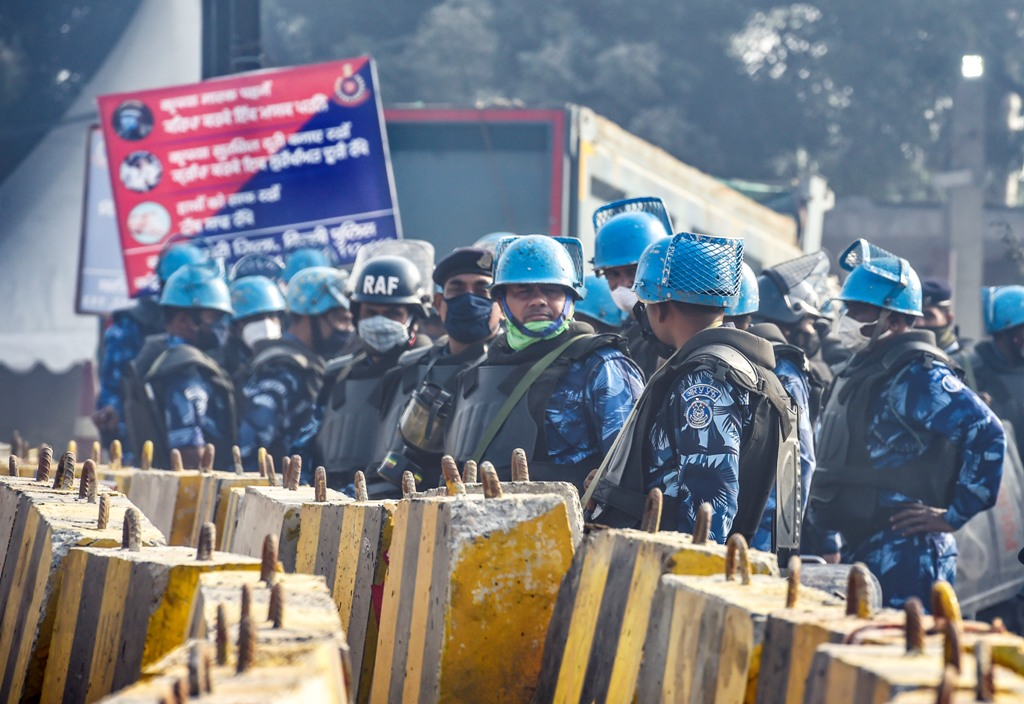 New Delhi: Security personnel stand guard at the Singhu border during ongoing farmers protest against the Centres farm reform laws, in New Delhi, Tuesday, Dec. 8, 2020. The farmers have called for a nationwide strike demanding repeal of the agri laws. (PTI Photo/Ravi Choudhary)(PTI08-12-2020 000021B)