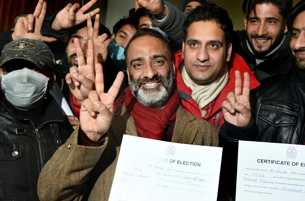 Srinagar: National Conference (NC) candidate Salmaan Sagar flashes victory sign after his lead in the municipality election results, in Srinagar, Tuesday, Dec. 22, 2020. (PTI Photo/S. Irfan)(PTI22-12-2020 000123B)