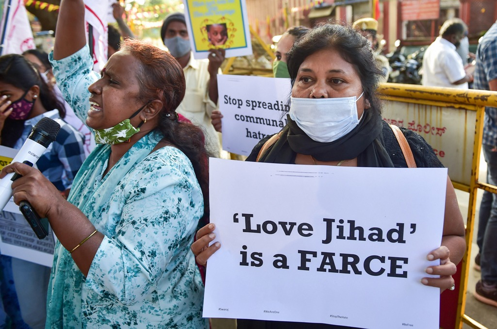 Bengaluru: Activists hold placards and raise slogans against the Karnataka government decision to enact love Jihad law on Decemeber 1, 2020. PTI Photos.