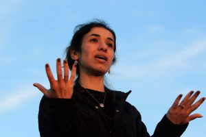 FILE PHOTO: Nobel Peace Prize laureate, Yazidi activist Nadia Murad gestures while talking to the people during her visit to Sinjar, Iraq December 14, 2018. REUTERS/Ari Jalal