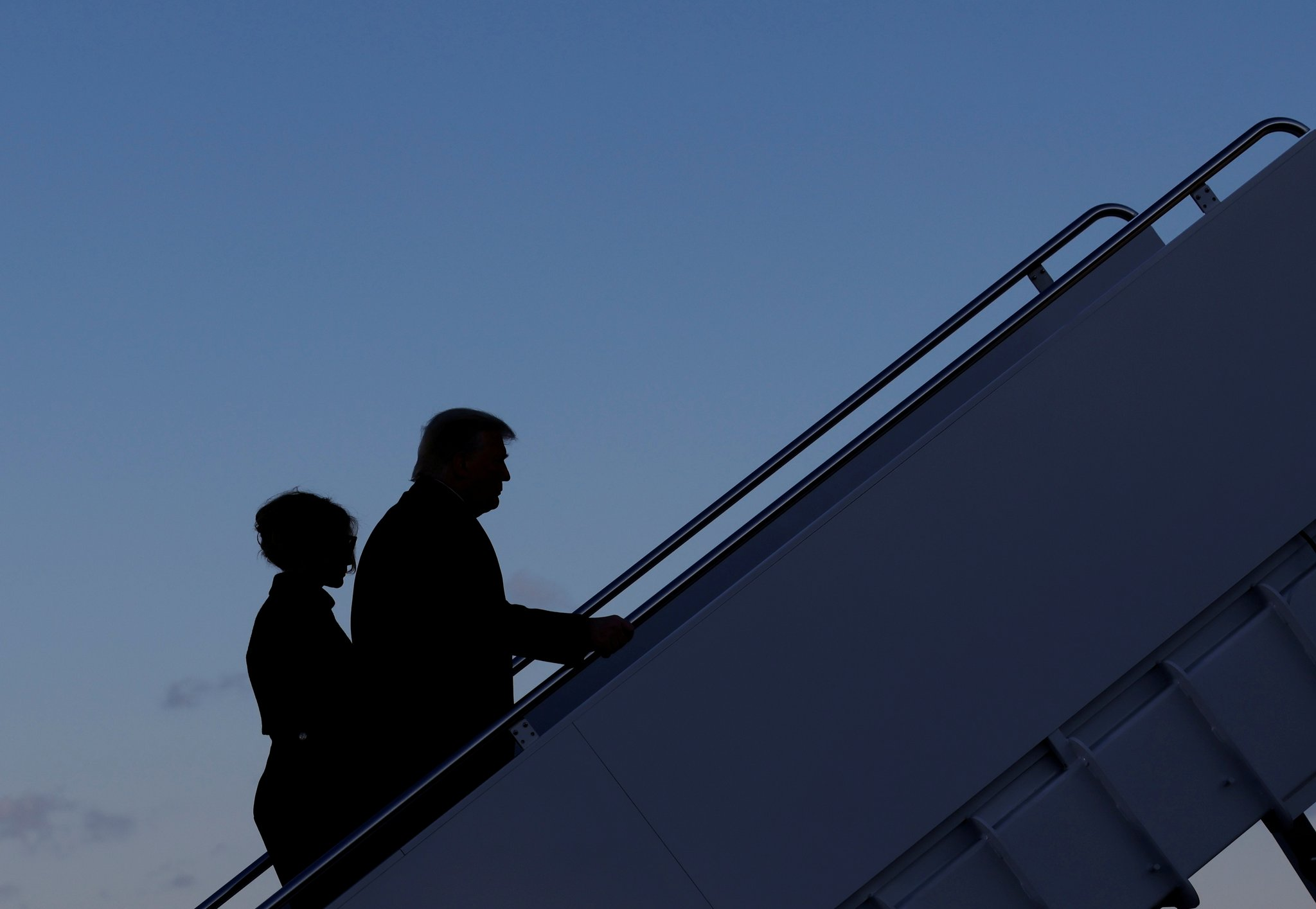 President Donald Trump departs next to first lady Melania Trump from Joint Base Andrews to fly to Florida. REUTERS/Carlos Barria