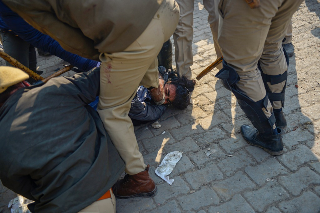 New Delhi: Police pin down a farmer, who allegedly attacked Police SHO (Alipur) Pradeep Paliwal, during clashes between people claiming to be local villagers and farmers at the Singhu Border in New Delhi, Friday, Jan. 29, 2021. (PTI Photo/Ravi Choudhary)(PTI01 29 2021 000235B)