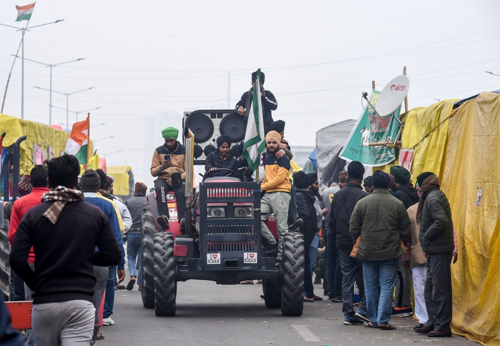 New Delhi: Farmers ride a tractor during their ongoing agitation against the Centres farm reform laws, a Ghazipur border in New Delhi, Sunday, Jan. 24, 2021. (PTI Photo/Atul Yadav)(PTI01 24 2021 000131B)