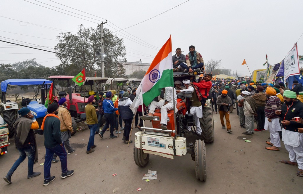 New Delhi: Farmers ride a tractor at Singhu border during an ongoing protest against the new farm laws, in New Delhi, Sunday, Jan. 24, 2021. (PTI Photo/Manvender Vashist)(PTI01 24 2021 000083B)