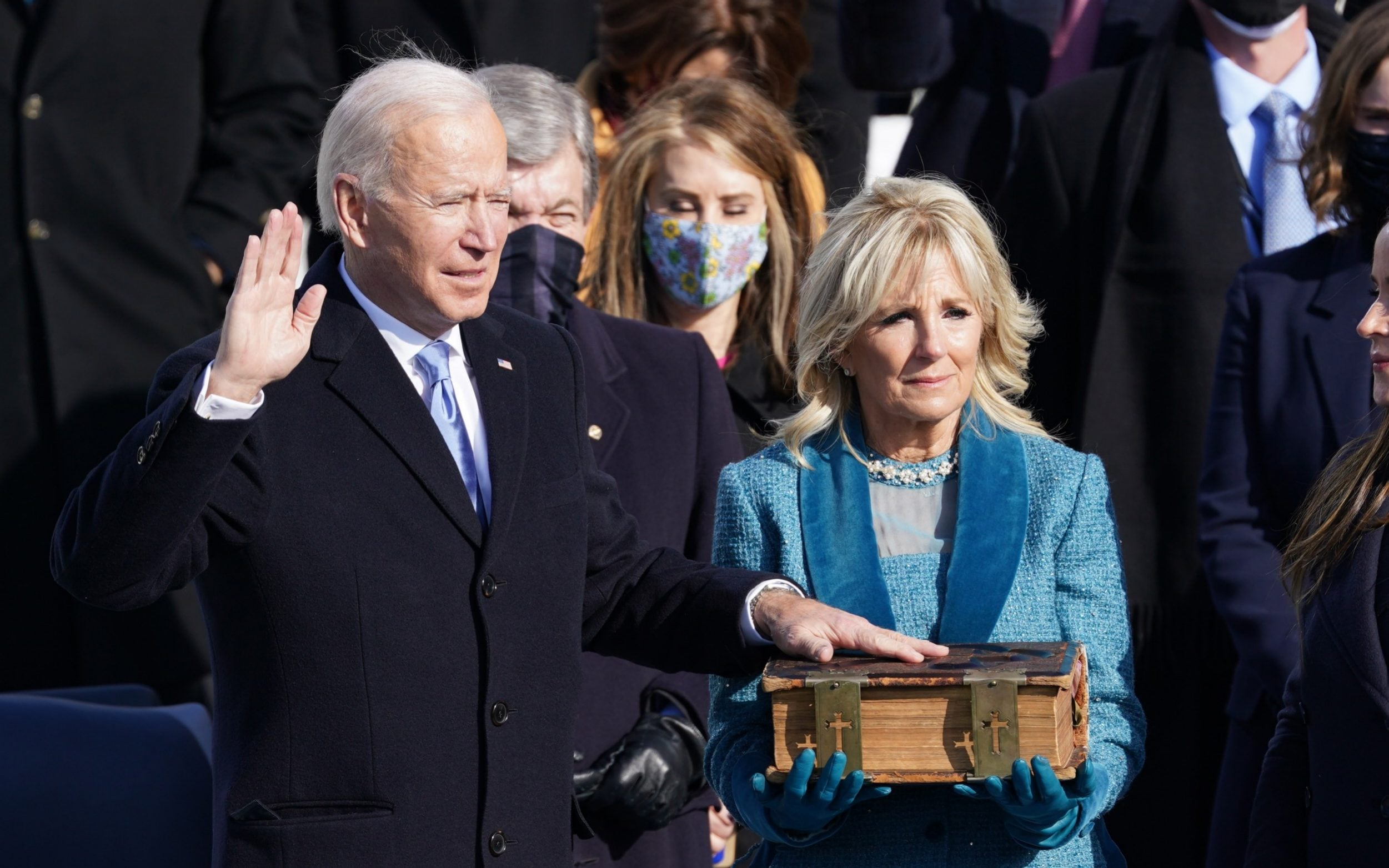 Joe Biden is sworn in as the 46th President of the United States as his wife Jill Biden holds a bible on the West Front of the US Capitol in Washington., January 20, 2021. Photo: Reuters/Kevin Lamarque