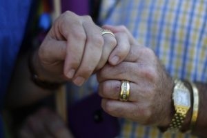 Married couple Bill Hacket, 53, (L) and Thom Uber hold hands in West Hollywood, California, after the U.S. Supreme Court ruled on California's Proposition 8 and the federal Defense of Marriage Act, June 26, 2013. REUTERS/Lucy Nicholson