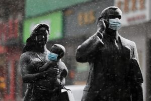 Statues with face masks on are seen amid snow in Wuhan, the epicentre of the novel coronavirus outbreak, in Hubei province, China February 15, 2020. China Daily via REUTERS