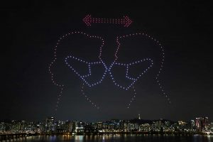 Drones fly over the Han river showing messages to support the country as measures to avoid the spread of the coronavirus continue, in Seoul, South Korea, July 4, 2020. Yonhap via REUTERS