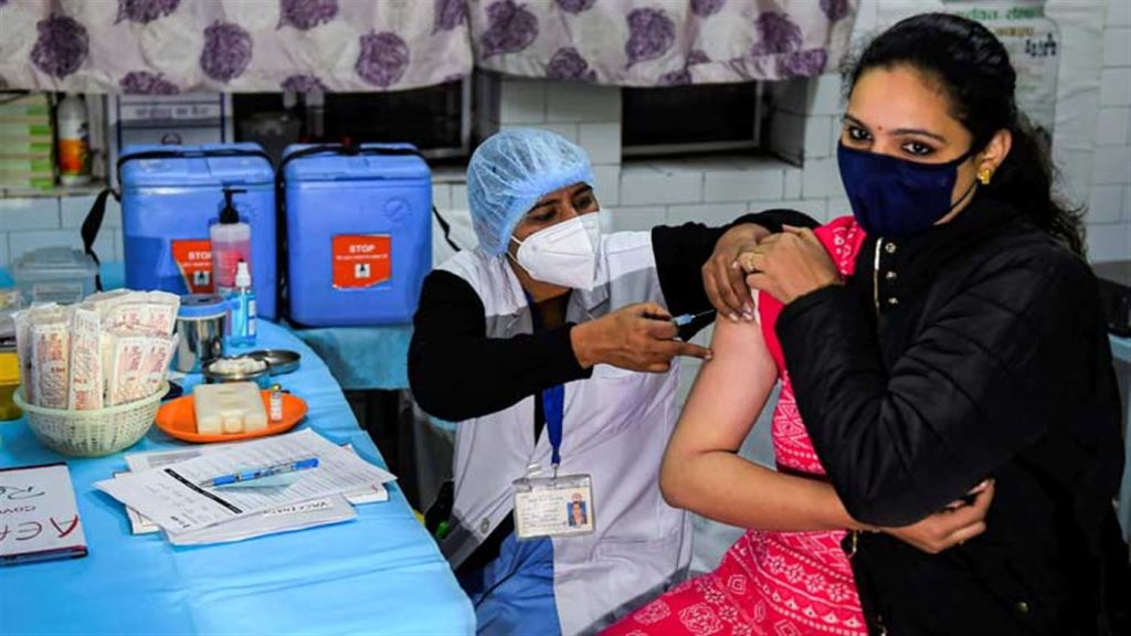 A health worker conducts the dry run of COVID-19 vaccination at a healthcare center in Daryaganj, New Delhi | PTI