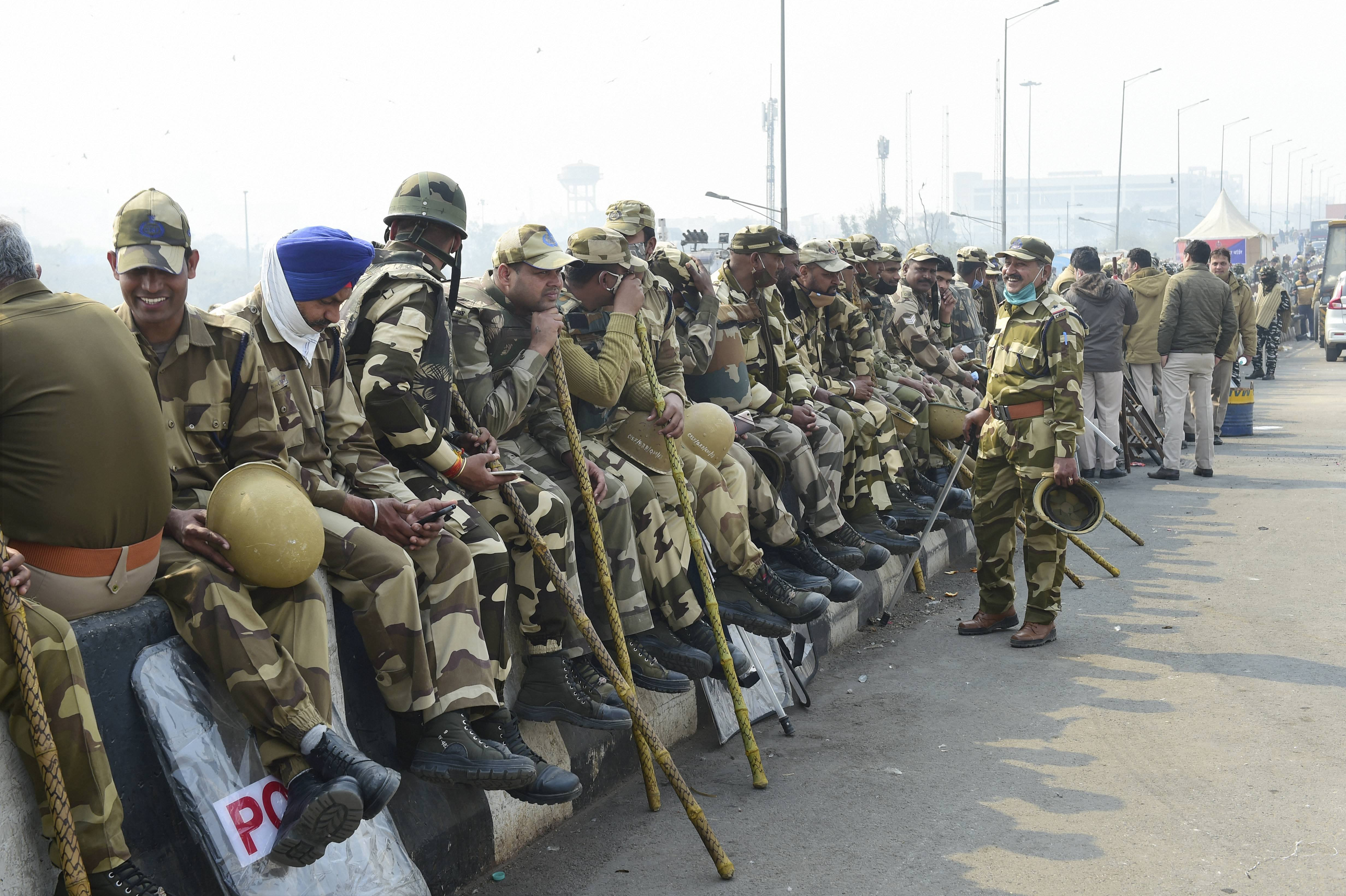 New Delhi: Security personnel keep vigil at Ghazipur border during the ongoing farmers' agitation against Centre's farm reform laws, in New Delhi, Monday, Feb. 1, 2021. (PTI Photo/Kamal Kishore)(PTI02_01_2021_000093B)