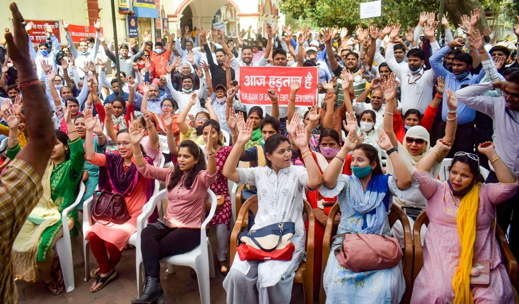 Prayagraj: Bank employees raise slogans during the second day of a nationwide strike, called by United Forum of Bank Unions (UFBU), against the proposed privatisation of two state-owned lenders, in Prayagraj, Tuesday, March 16, 2021. (PTI Photo)(PTI03 16 2021 000090B)