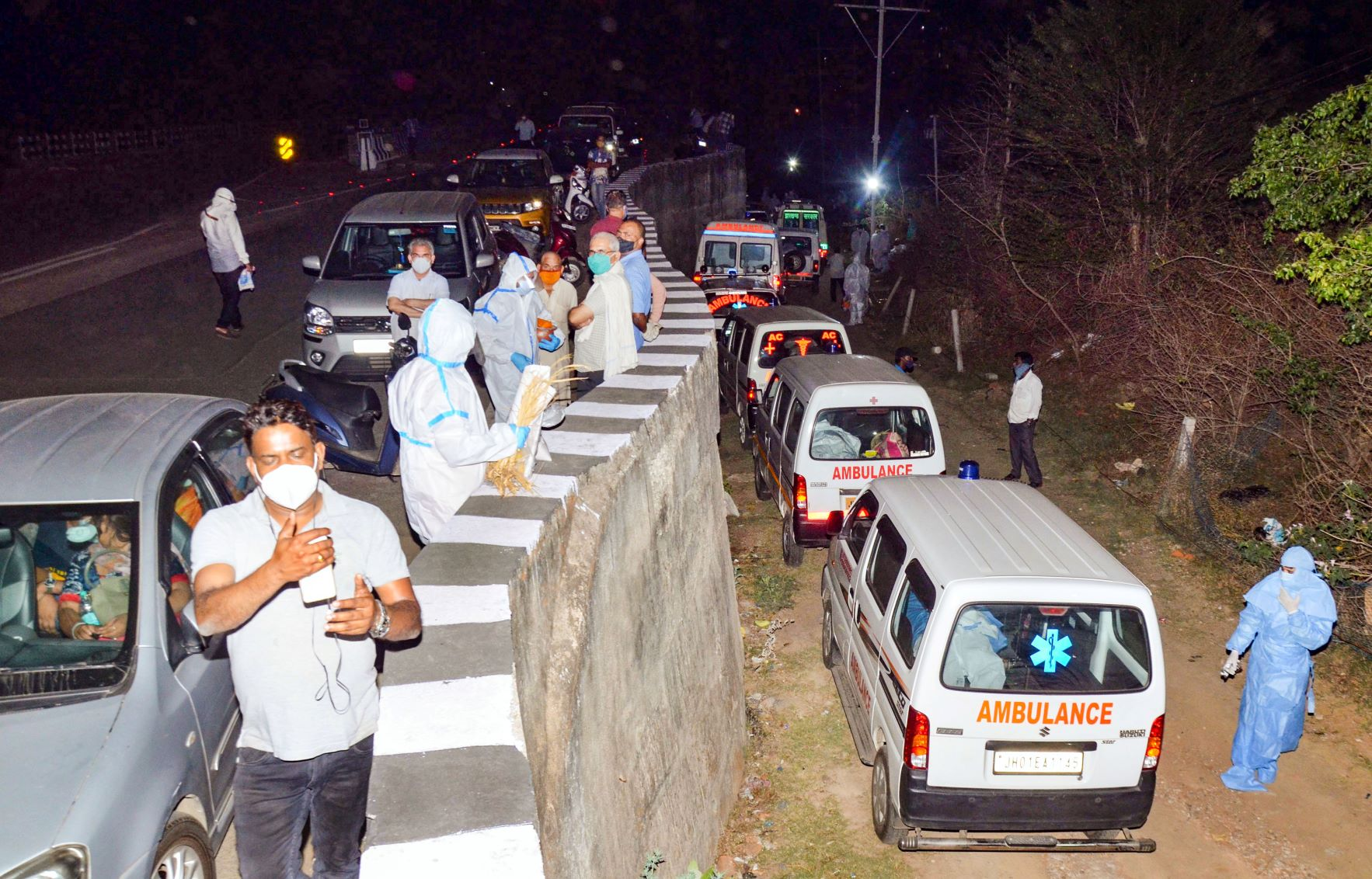 Ranchi: Ambulances, carrying the mortal remains of those who died of COVID-19, stand parked outside a crematorium, in Ranchi, Sunday night, April 11, 2021. (PTI Photo)(PTI04 12 2021 000025B)