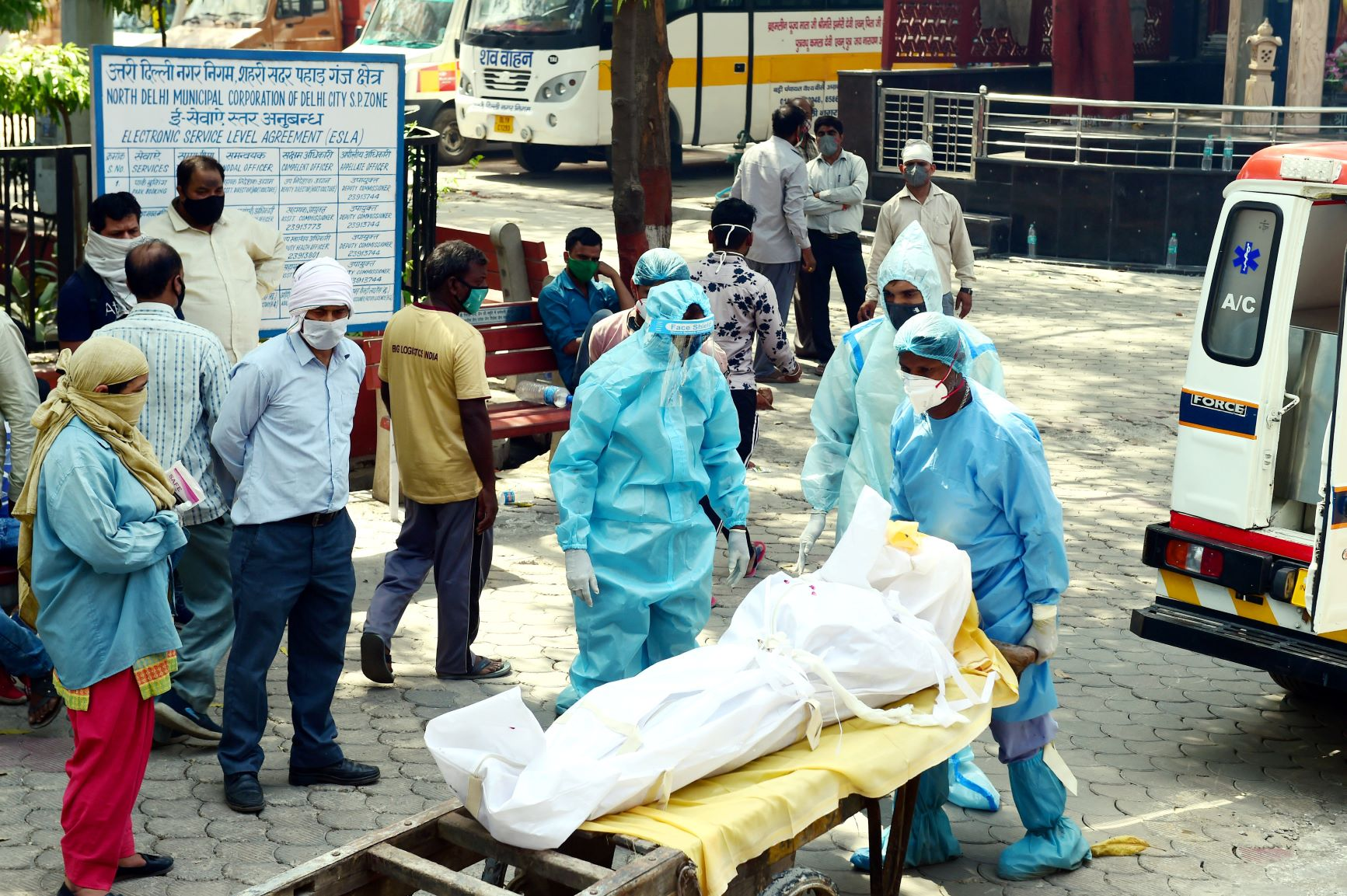 New Delhi: A person who died of COVID-19 being taken for cremation, amid a spike in coronavirus cases countrywide, at Nigam Bodh Crematorium in New Delhi, Wednesday, April 14, 2021. (PTI Photo/Kamal Kishore)(PTI04 14 2021 000087B)