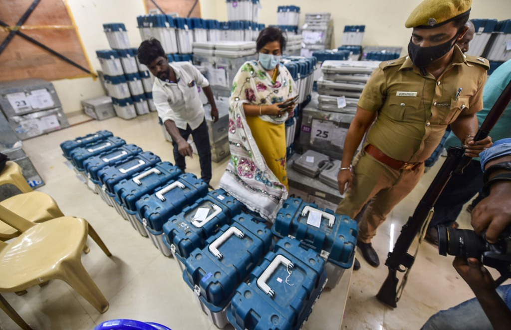 Chennai: Polling officials check Electronic Voting Machines (EVMs) and other necessary inputs required for the TN Assembly elections, at a distribution centre in Chennai, Monday, April 5, 2021. (PTI Photo/R Senthil Kumar)(PTI04 05 2021 000139B)