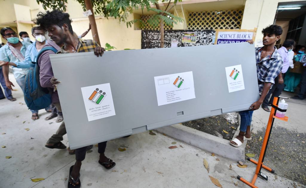 Chennai: Workers carry election materials required for the TN Assembly polls, at a distribution centre in Chennai, Monday, April 5, 2021. (PTI Photo/R Senthil Kumar)(PTI04 05 2021 000137B)
